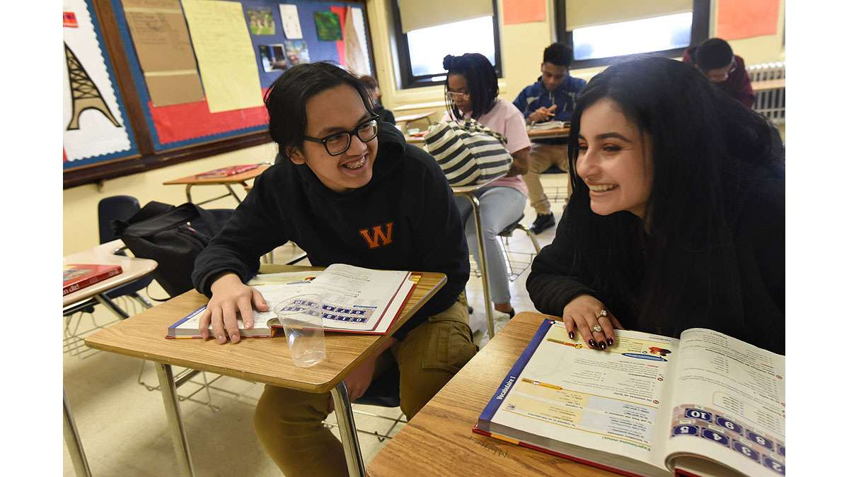 Minh Le, 16; and Janneiry Martinez, 17; in Paula Saillard's French class at Woodrow Wilson High School.