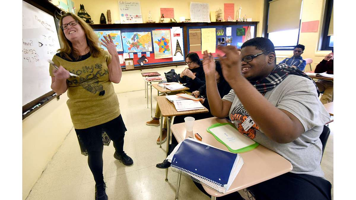 In her French class at Woodrow Wilson High School, teacher Paula Saillaird shares a lighter moment with student Dyrell Mack, 18.