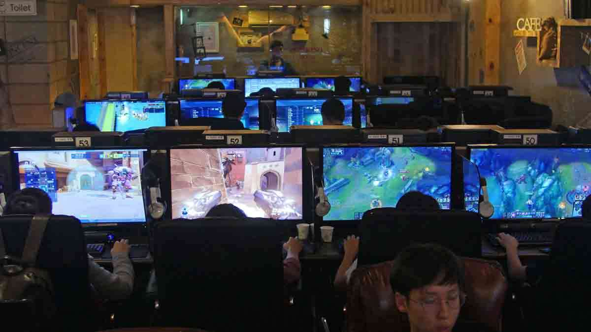 In this Aug. 30, 2016 photo, people play computer games at a PC cafe in Seoul, South Korea. South Korea has the biggest e-sports industry in the world with professional leagues and broadcasting channels.