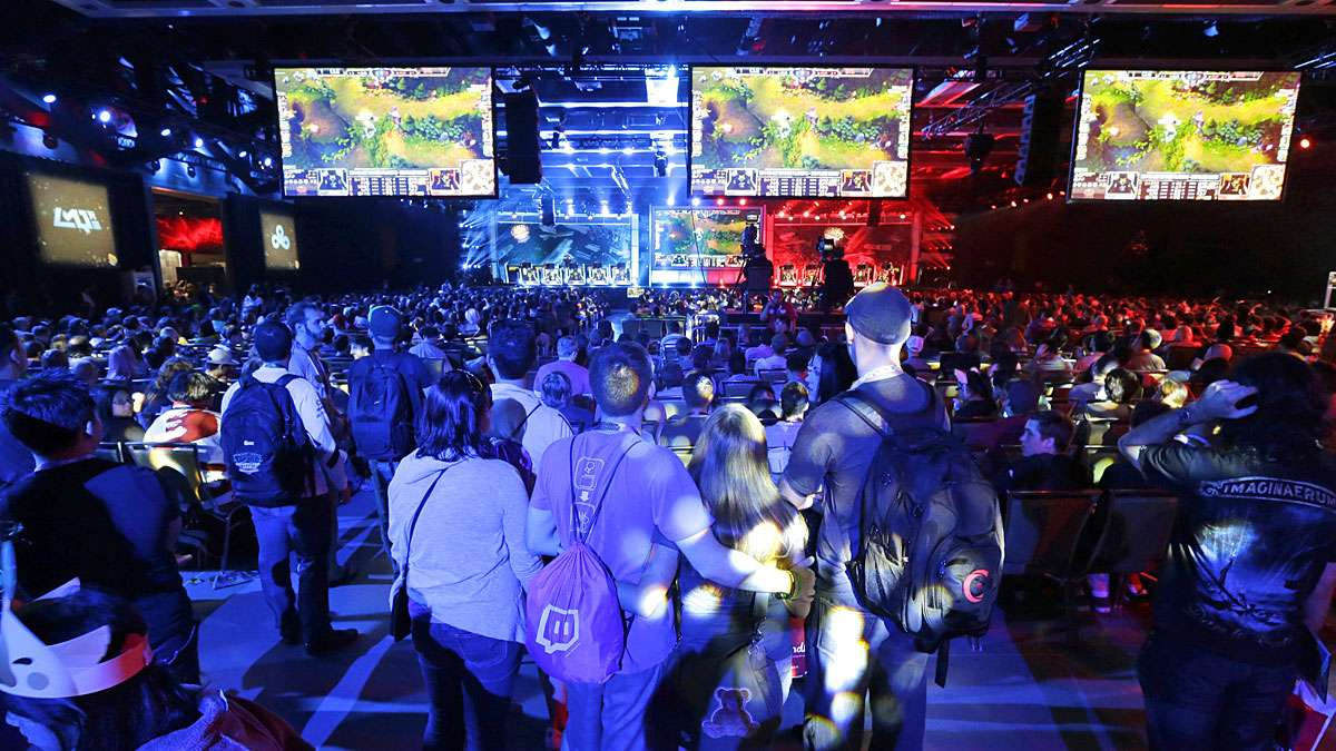 In Seattle hundreds of spectators filled an exhibition hall to watch a round of the League of Legends championship series video game competition, Friday, Aug. 29, 2014, at the Penny Arcade Expo, which attracted nearly 85,000.