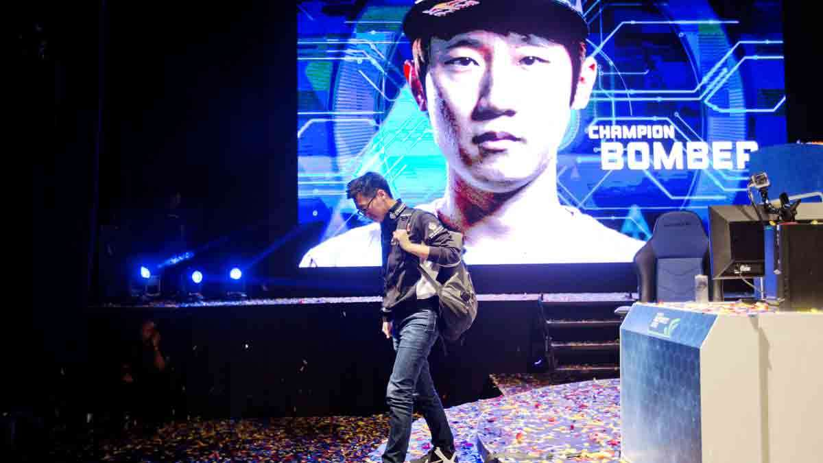In this July 13, 2014 photo, Choi 'PoLt' Seong Hun steps off the stage after losing the championship game to Choi 'Bomber' Ji Sung, both of South Korea, in Atlanta.