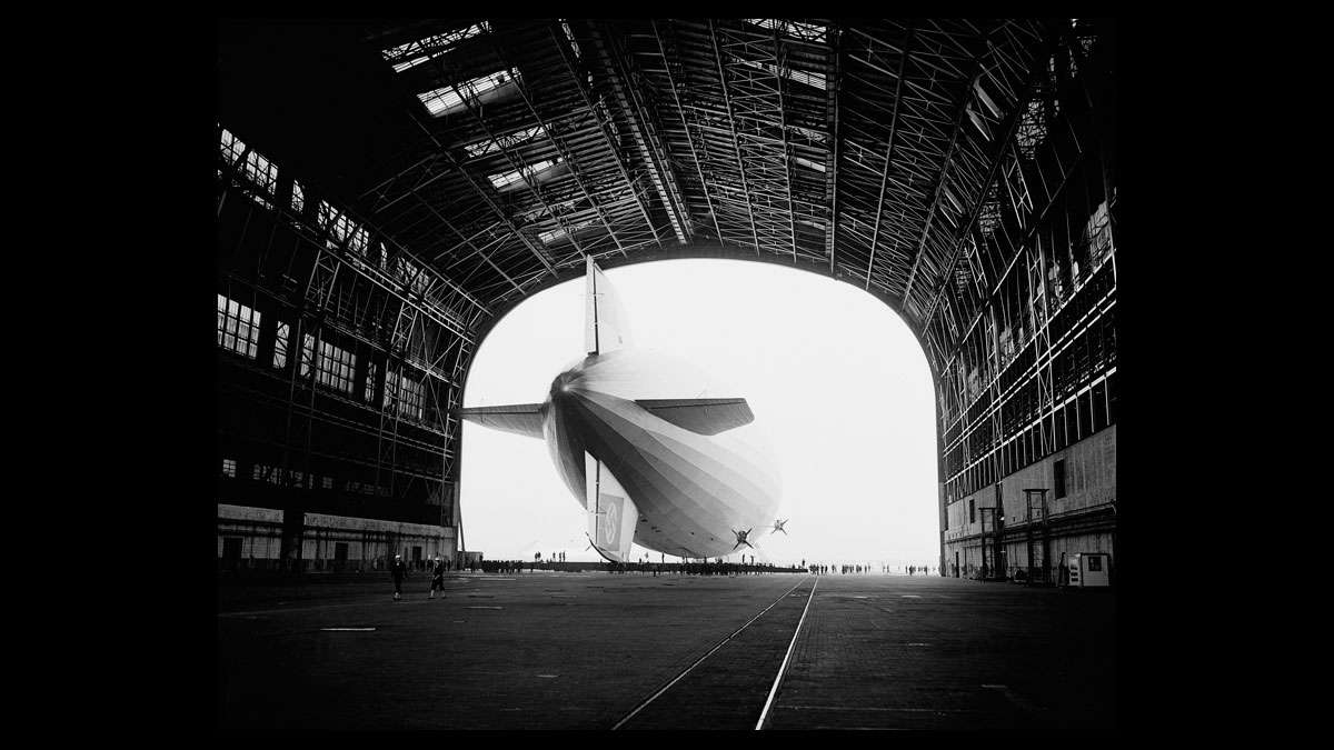 The German-built zeppelin Hindenburg is shown from behind, with the Swastika symbol on its tail wing, as the dirigible is partially enclosed by its hangar at the U.S. Navy Air Station in Lakehurst, N.J., May 9, 1936.
