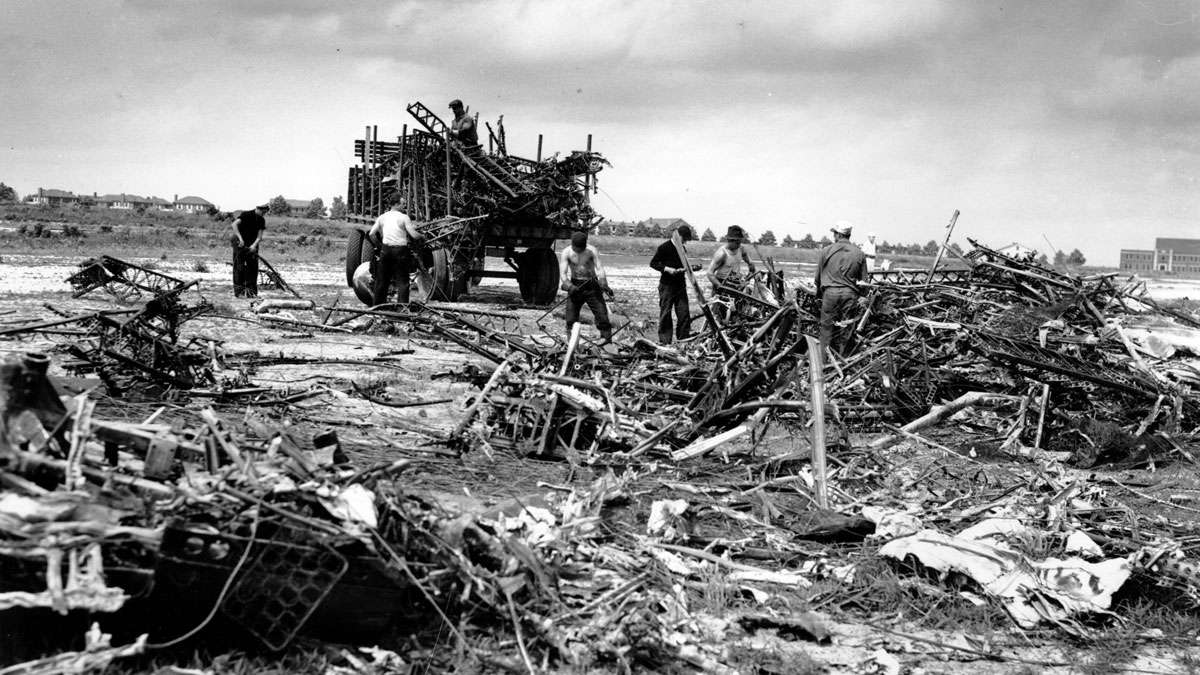 The remains of the wreckage of the German Zeppelin Hindenburg are removed from the U.S. Naval field in Lakehurst, N.J., on May 15, 1937. The airship exploded mid-air prior to landing May 6.