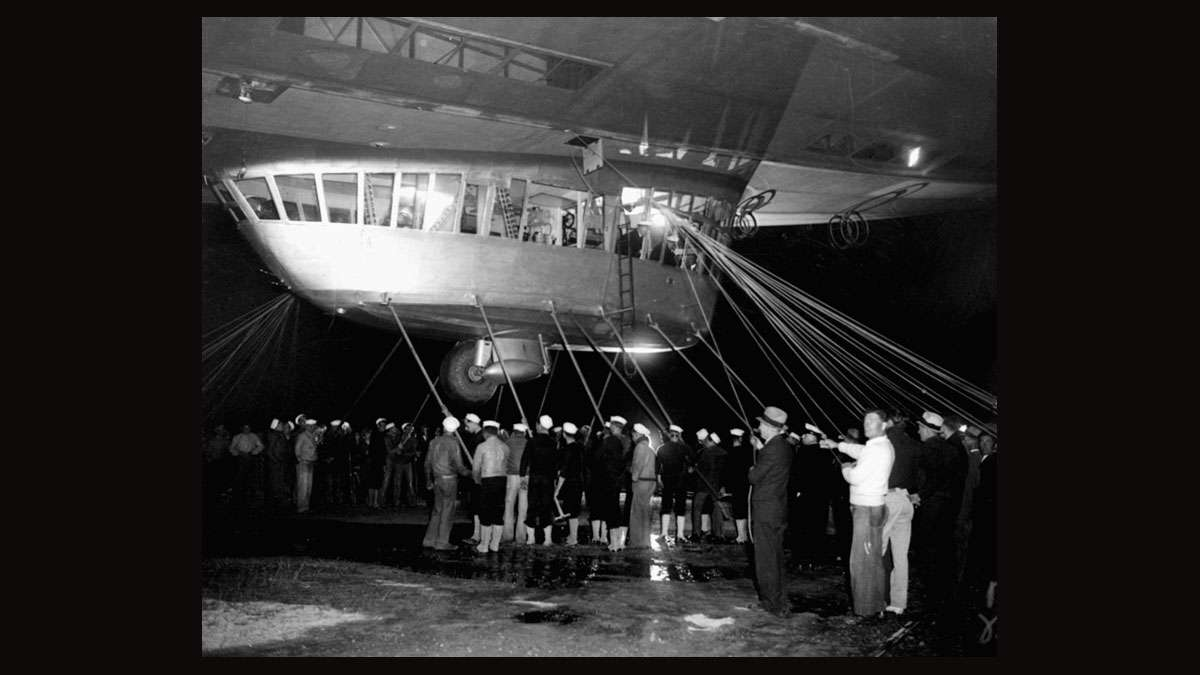 Spectators and ground crew surround the gondola of the German zeppelin Hindenburg as the lighter-than-air ship prepared to depart the U.S. Naval Station at Lakehurst, NJ, May 11, 1935, on its return trip to Germany.