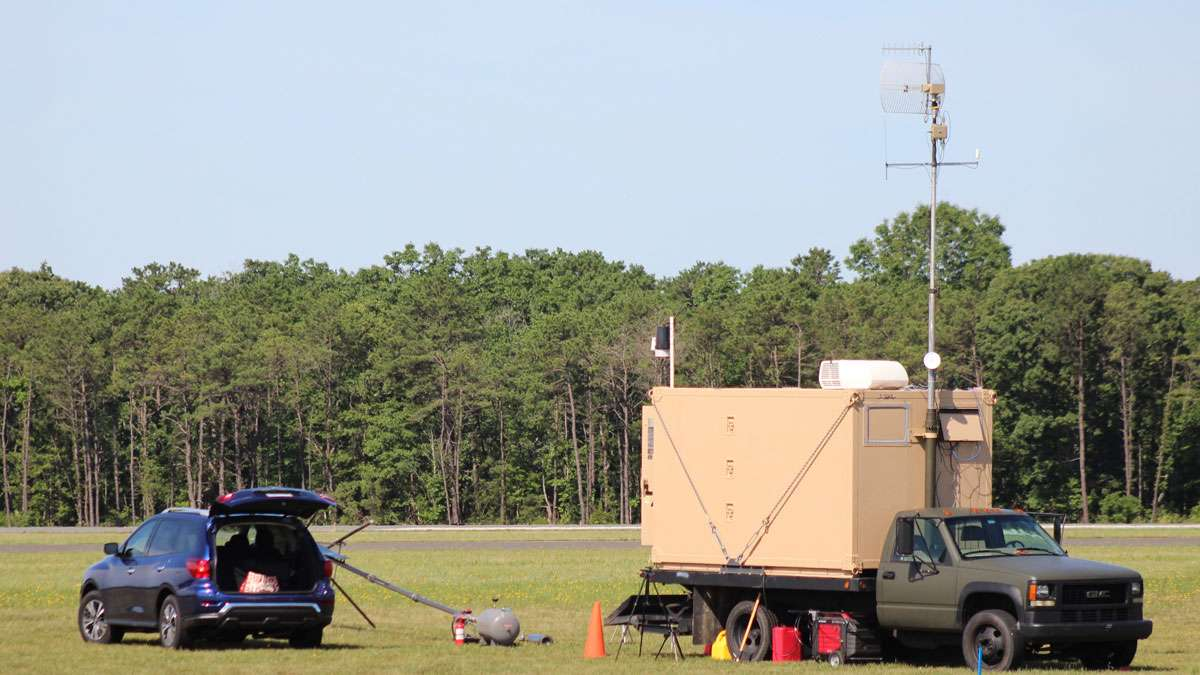A mobile command vehicle is parked where the drone was launched in Woodbine, N.J.