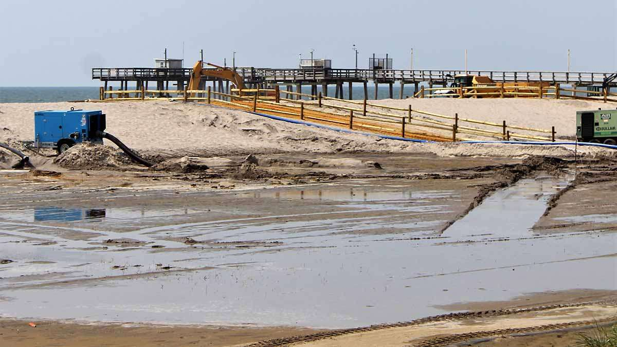 The Army Corps of Engineers is building a dune that is designed to protect homes from storm surge.