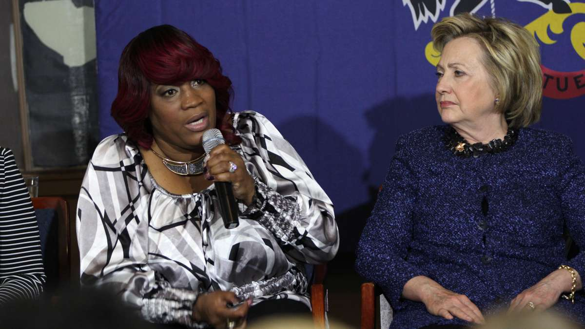 During a campaign stop in Philadelphia, Democraticc presidential candidate Hillary Clinton listens as Tanya Brown-Dickerson talks about the fatal shooting of her son, Brandon Tate-Brown, by a Philadelphia police officer. (Emma Lee/WHYY)