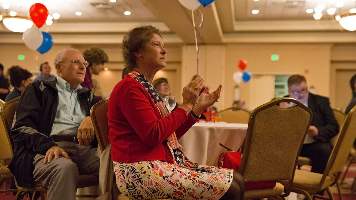 Meg Leister of Emmaus, Pennsylvania, applauds as Republican presidential candidate Donald Trump pulls ahead of Democratic candidate Hilary Clinton during a watch party for U.S. Senator Pat Toomey. (Lindsay Lazarski/WHYY)