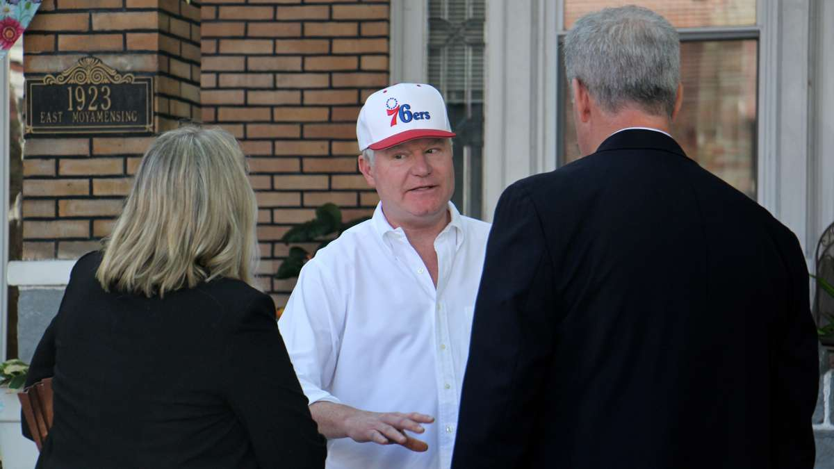 John ''Johnny Doc'' Dougherty talks with law enforcement agents after his South Philadelphia home was raided by the FBI. (Emma Lee/WHYY)
