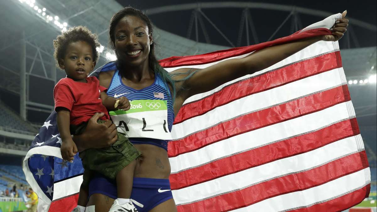 Philadelphia native Nia Ali wins the silver medal in the 100-meter hurdles at the 2016 Summer Olympics in Rio de Janeiro. She poses with her 15-month-old son Titus Wednesday, Aug. 17, 2016. (AP Photo/Matt Dunham)