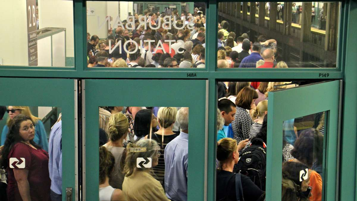 Regional rail passengers pack the platforms at Suburban Station at rush hour on July 5, 2016, after structural defects were found in Silverliner V railcars. Rail commuters' woes returned in November when a strike shut down the city's subway, bus, and trolley system. (Emma Lee/WHYY)