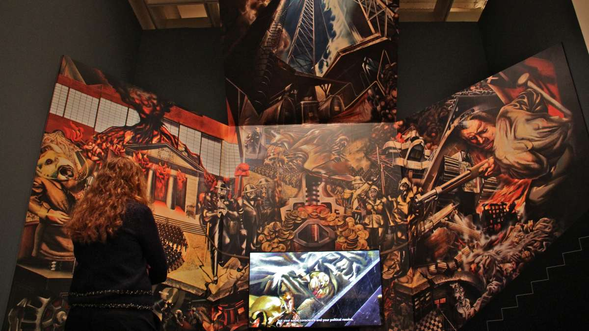 ''Portrait of the Bourgeoisie'' by David Alfaro Siqueiros occupies a stairwell at the Mexican Electricians' Syndicate in Mexico City. It was recreated at the Philadelphia Museum of Art for the exhibit, ''Paint the Revolution.'' (Emma Lee/WHYY)