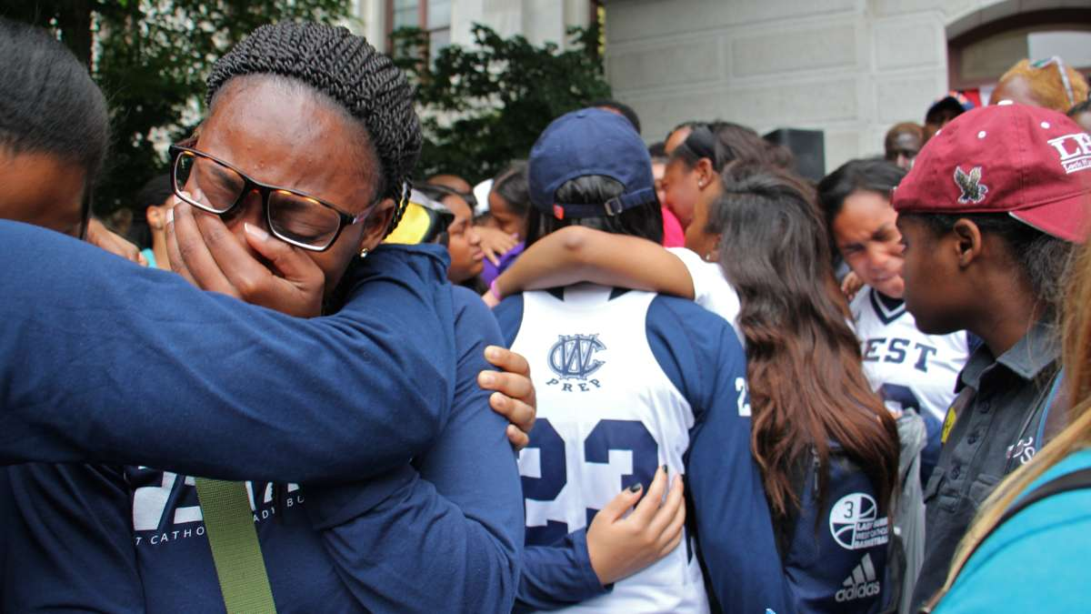 Students and alumni of West Catholic High School mourn the death of 18-year-old Akyra Murray, a recent graduate and basketball standout who was vacationing with her family in Orlando when she was killed at the Pulse night club. (Emma Lee/WHYY)