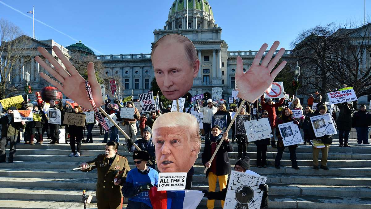 While Pennsylvania electors cast their ballots for Donald Trump on Dec. 19, 2016, protesters gather outside the capital in Harrisburg. (Bastiaan Slabbers for NewsWorks)