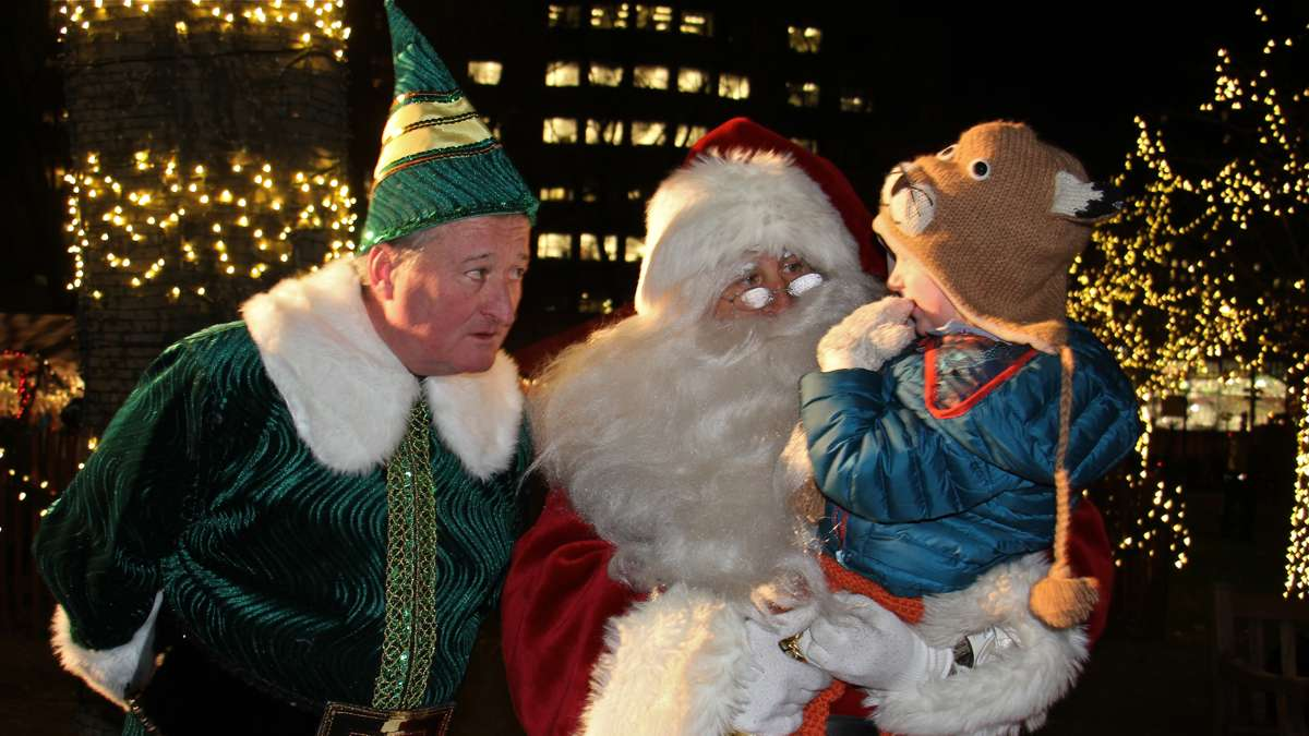 Mayor Jim Kenney as Buddy the Elf spreads Christmas cheer at Franklin Square. (Emma Lee/WHYY)