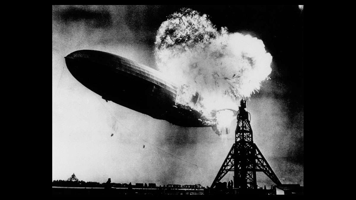 File - This May 6, 1937 file photo, taken at almost the split second that the Hindenburg exploded, shows the 804-foot German zeppelin just before the second and third explosions send the ship crashing to the earth over the Lakehurst Naval Air Station in Lakehurst, N.J. (AP Photo)