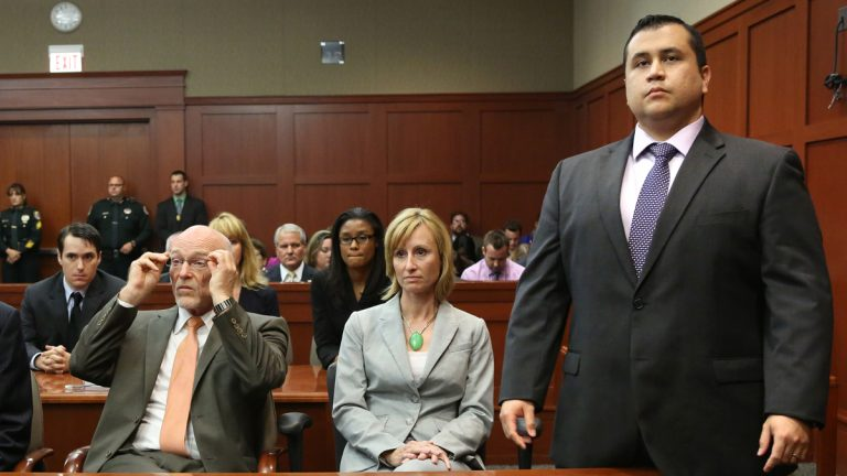 George Zimmerman stand as the jury enters the courtroom at the Seminole Circuit Court, in Sanford, Fla., Saturday, July  13, 2013. Neighborhood watch captain George Zimmerman was cleared of all charges Saturday in the shooting of Trayvon Martin.  Next to him are defense counsel Lorna Truett, and Don West.  (AP Photo/Orlando Sentinel, Joe Burbank, Pool)