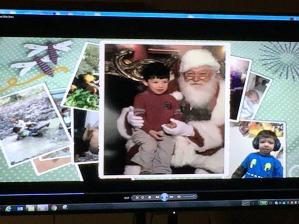 Photos on a computer screen of slain Brendan Creato, sitting on Santa's lap, etc.