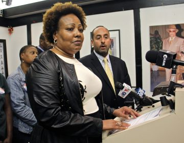 Rochelle Bilal (center), president of the Guardian Civic League, and Brian Mildenberg (right) attorney for a group of African American police officers, level charges of racism against the leadership at the Philadelphia narcotics unit. (
