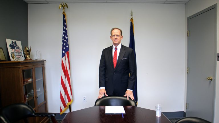 U.S. Sen. Pat Toomey stands in a conference room at his Philadelphia office. (Emma Lee/WHYY)