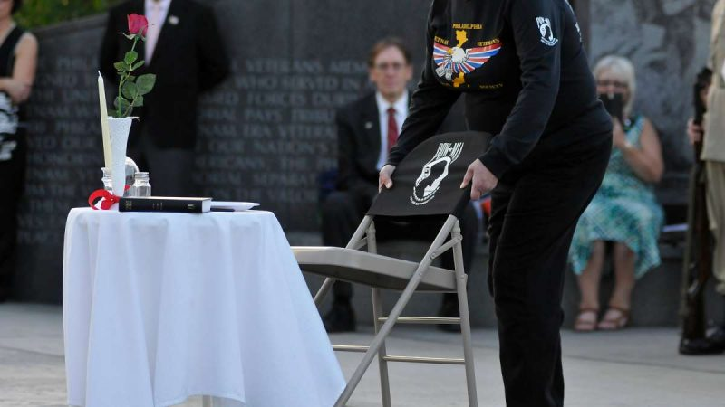 An empty chair is symbolically placed, concluding a ''Missing Man'' ceremony performed by members of the Philadelphia Vietnam Veterans Memorial Society, at the Memorial on Friday.