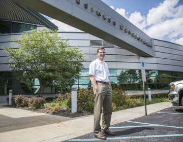 Steven McKnight in front of the building that houses the Altoona Blair County Development Corp., where he's the president and CEO. He started the First Frontier campaign to bring natives and newcomers to Altoona. (MIN XIAN / WPSU)