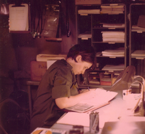 Marsha Four works at her desk at the 18th Surgical Hospital in Vietnam.
