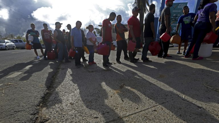 People wait in line for gas, in the aftermath of Hurricane Maria, in Aibonito, Puerto Rico, Monday, Sept. 25, 2017.