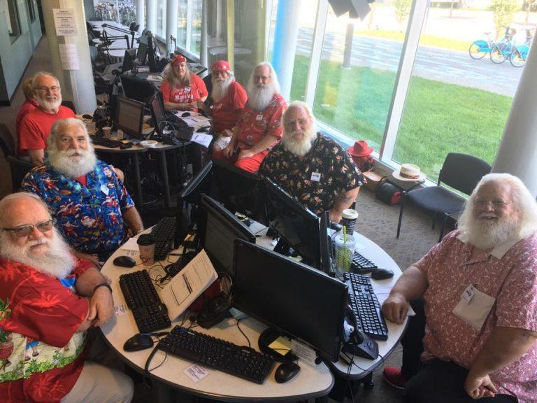 Santas take calls for a WHYY-FM pledge drive