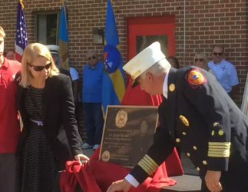 Families of the three fallen firefighters unveiled plaques in their honor.(Zoë Read/WHYY)