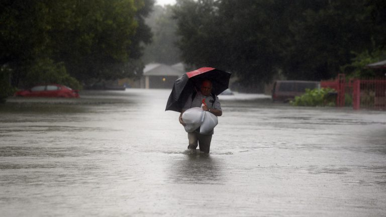 Eldemiro Chavaria walks in floodwaters from Tropical Storm Harvey as he leaves his neighborhood in Houston, Texas, Monday. Forecasters are evaluating whether New Jersey will be n the path of a hurricane this season.(AP Photo/LM Otero)