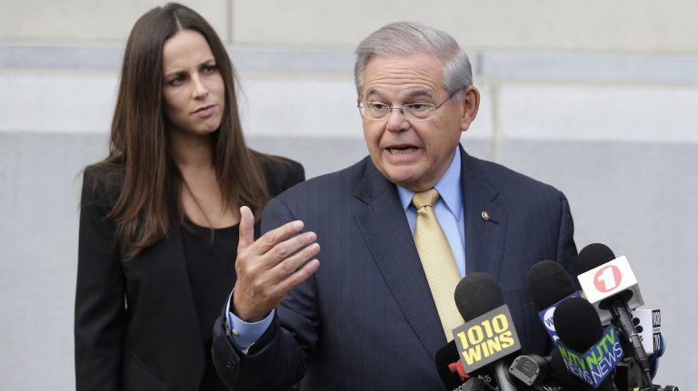 U.S. Sen. Bob Menendez talks to reporters last week as he arrives to court for his federal corruption trial in Newark, N.J., as his daughter Alicia Menendez looks on. (AP Photo/Seth Wenig, File)