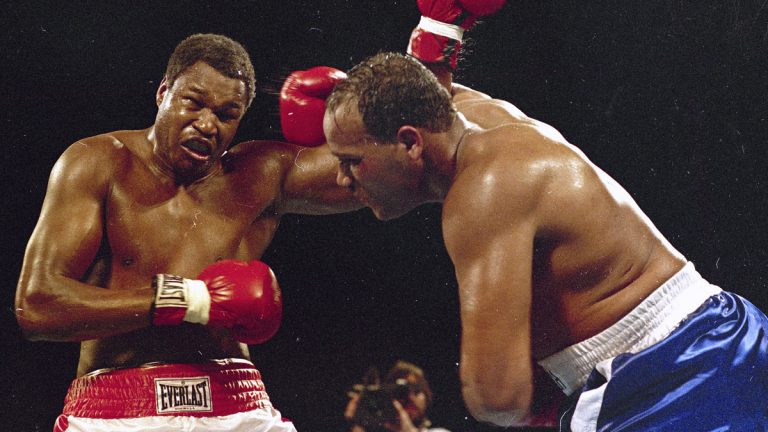 In March 1985, Larry Holmes, left, battles David Bey during a bout in Las Vegas. Bey, a former heavyweight boxing champ from Philadelphia nicknamed