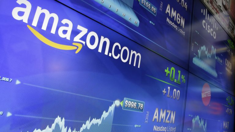 In this Tuesday, May 30, 2017, file photo, the Amazon logo is displayed at the Nasdaq MarketSite, in New York's Times Square. Amazon announced Thursday, Sept. 7, that it has opened the search for a second headquarters, promising to spend more than $5 billion on the opening. (Richard Drew/AP Photo, File)