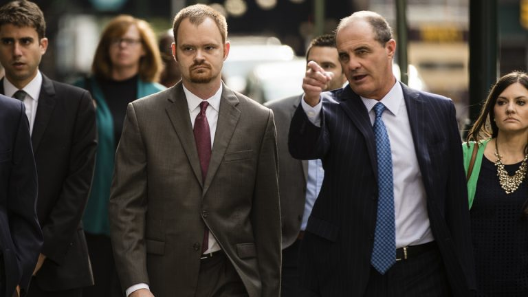 Brandon Bostian, (center), the Amtrak engineer charged in a Philadelphia derailment that killed eight in 2015, accompanied by his lawyer Brian McMonagle, (right), arrives for a preliminary hearing at the Criminal Justice Center in Philadelphia, Tuesday, Sept. 12, 2017. (Matt Rourke/AP Photo)