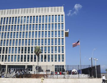 In this Aug. 14, 2015, file photo, a U.S. flag flies at the U.S. embassy in Havana, Cuba. U.S. investigators are chasing many theories about what's harming American diplomats in Cuba, including a sonic attack, electromagnetic weapon or flawed spying device. (Desmond Boylan/AP Photo, File)