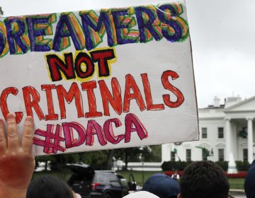In this Aug. 15, 2017 a woman holds up a signs in support of the Obama administration program known as Deferred Action for Childhood Arrivals, or DACA, during an immigration reform rally at the White House in Washington. After months of delays, President Donald Trump is expected to decide soon on the fate of so called 'dreamers' who were brought into the country illegally as children as he faces a looming court deadline and is digging in on appeals to his base. (Jacquelyn Martin/AP Photo, File)
