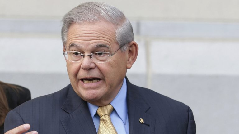 In this file photo, Sen. Bob Menendez talk to reporters as he arrives to court for his federal corruption trial in Newark, N.J., (Seth Wenig/AP Photo)