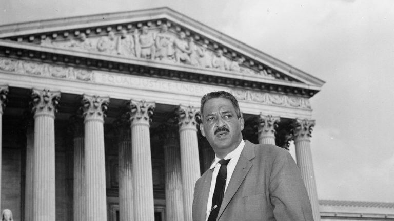 This Aug. 22, 1958 file photo shows Thurgood Marshall outside the Supreme Court in Washington.  Marshall, the head of the NAACP's legal arm who argued part of the case, went on to become the Supreme Court's first African-American justice in 1967. (AP Photo, File)