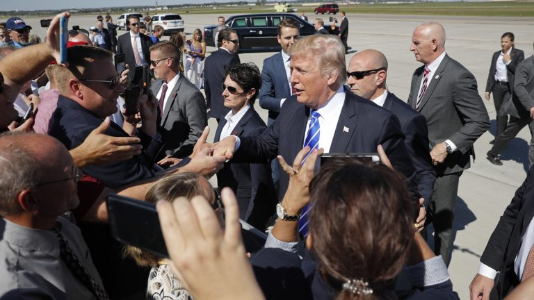 President Donald Trump greets supports on the tarmac upon his arrival at Bismarck Municipal Airport, Wednesday, Sept. 6, 2017 in Bismarck, N.D. Trump is in North Dakota to promote his tax overhaul pitch.