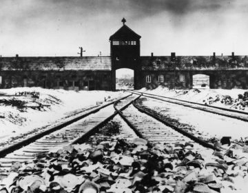 Entry to the concentration camp Auschwitz-Birkenau, Poland, with snow covered railtracks leading to the camp in February/March 1945.  (AP Photo/Stanislaw Mucha)