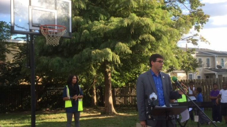 New Castle County Executive Matt Meyer talks about a new basketball hoop paid for by the county to replace one that was damaged by vandals. It's part of an effort to keep kids in the neighborhood out of trouble. (Zoë Read/WHYY)