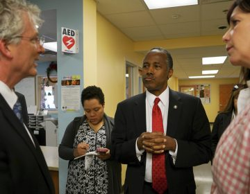 Ben Carson, secretary of Housing and Urban Development, is shown speaking with city and housing officials at a shelter in Columbus, Ohio, in April. (AP Photo/Dake Kang, file)