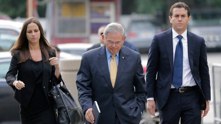 Sen. Bob Menendez, center, arrives with his children, Alicia Menendez and Robert Menendez Jr., to court for his federal corruption trial in Newark, N.J., Wednesday, Sept. 6, 2017. (AP Photo/Seth Wenig)