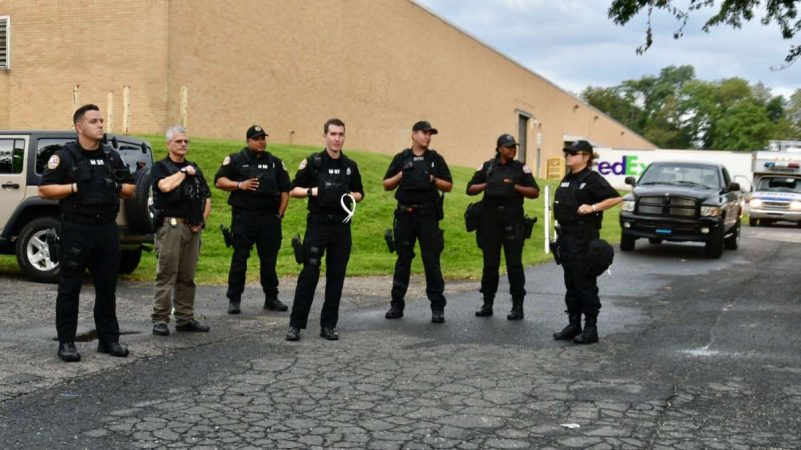 Police officers are posted outside the FOP in Northeast Philadelphia as members of the local law enforcement community hold a rally on Thursday. (Bastiaan Slabbers for NewsWorks)