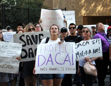Protesters march in Philadelphia to demand protection for  immigrants who arrived in the U.S. illegally as children and have been given a path to citizenship through DACA (Deferred Action for Childhood Arrivals). (Emma Lee/WHYY)