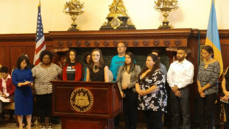Dreamers join with Philadelphia and federal officials at announcement of DACA dreamer fund. (Tom MacDonald/WHYY)