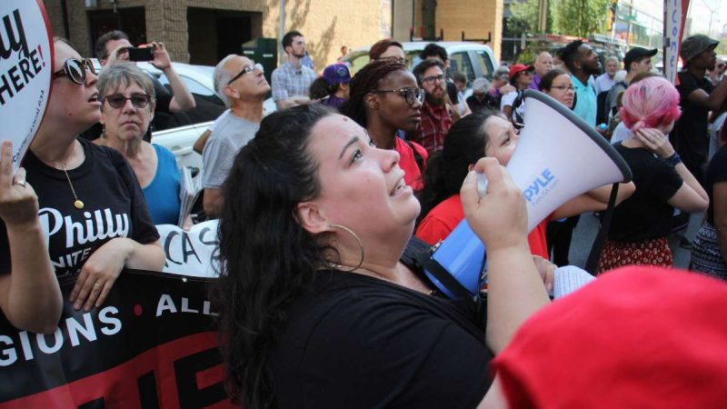 Erika Almiron, of the Latino immigrant rights organization Juntos, pleads for the continuation of DACA with protesters who gathered on Arch Street outside the Federal Prison.