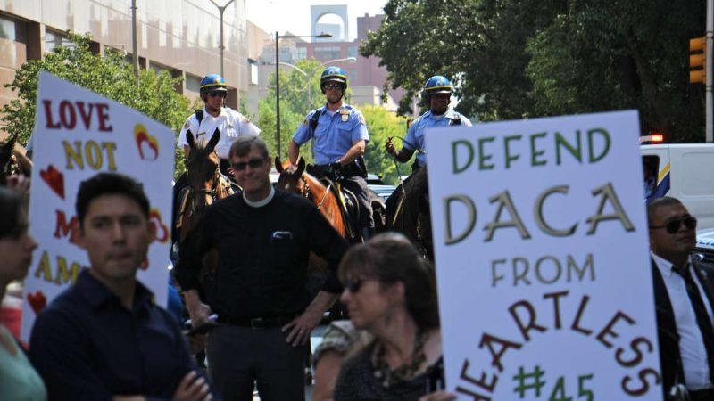 Mounted police follow protesters on Arch Street as they wind their way through Center City.