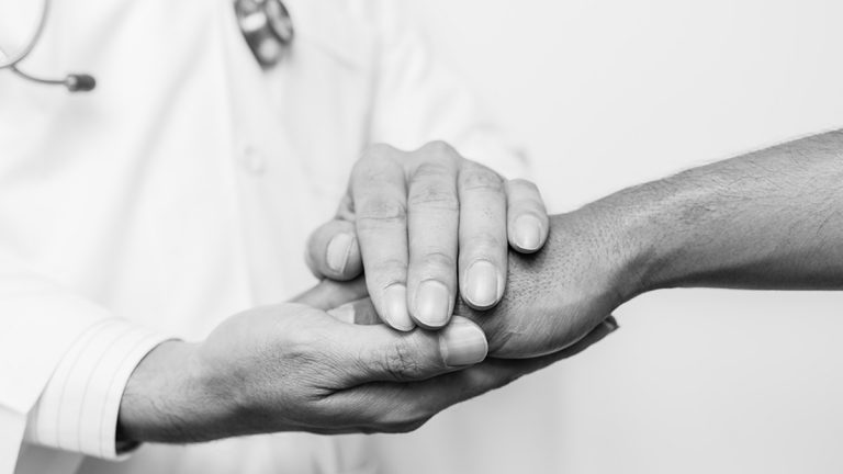 (<a href='https://www.bigstockphoto.com/image-159092963/stock-photo-two-people-holding-hands-for-comfort-black-and-white-doctor-s-hands-holding-patient-s-hand-for-encouragement-and-empathy-doctor-concept-doctor-man-doctor-support-doctor-talk-doctor-trust-doctor-shake-doctor-waiting'>karn684</a>/Big Stock Photo)